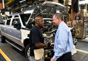 Joe Hinrichs (right), executive vice president and president, The Americas, Ford Motor Company tours the assembly line of the Kentucky Truck Plant.