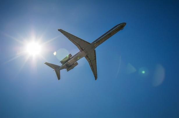 jet-airplane-in-the-sky-with-sun-public-domain