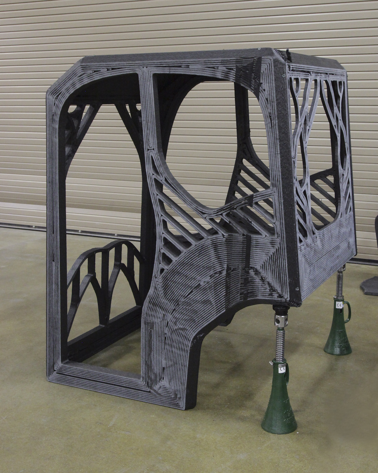 The first-ever 3D printed excavator project includes an excavator cab designed by a University of Illinois at Urbana-Champaign student engineering team, which was printed at DOE's Manufacturing Demonstration Facility at ORNL using carbon fiber-reinforced ABS plastic as a prototype.
