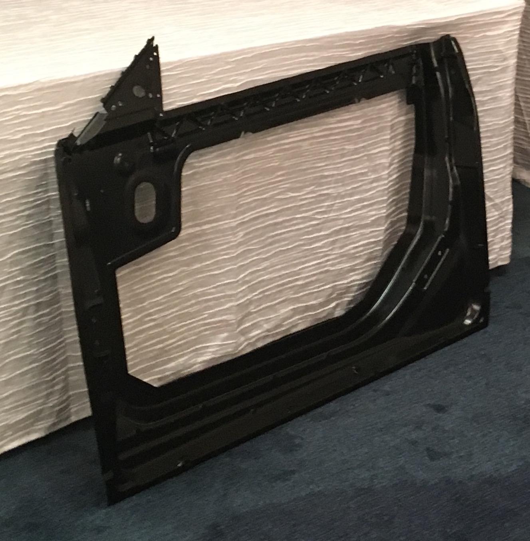 applied-header door panel