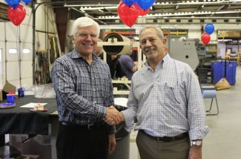 John Barneson (left), senior vice president of Corporate Development at Kaiser Aluminum Corporation, and Chris Joest (Right), president of Imperial Machine & Tool Co., celebrating the successful completion of the acquisition.
