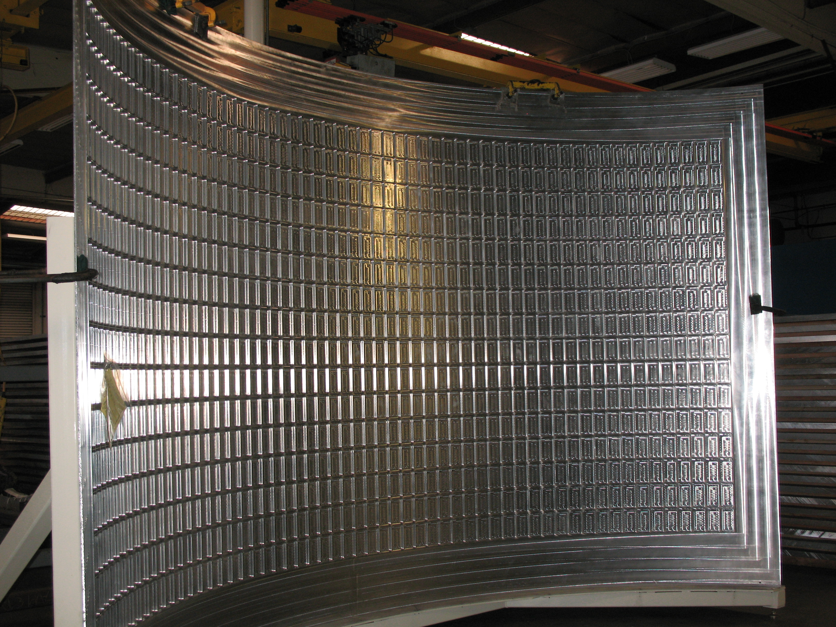 Figure 9. An example of an aluminum alloy panel after machining, forming, and artificial aging operations.