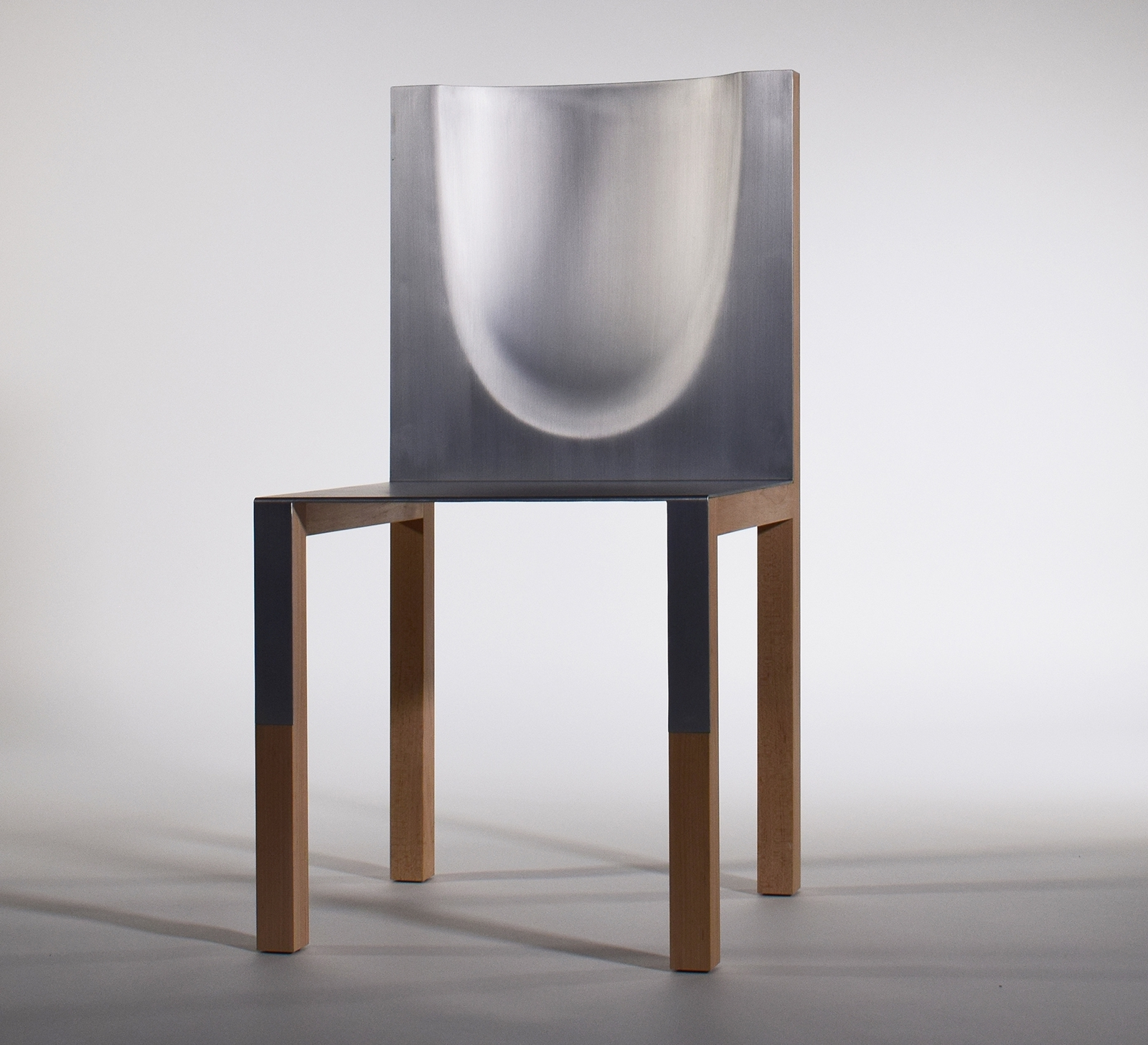 """Shades of Michelangelo"" is a chair made of aluminum and wood."