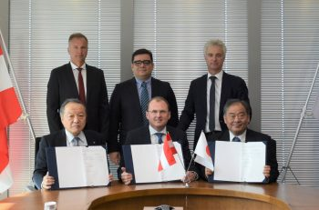 Signing of the sales cooperation agreement in Tokyo — Front row (L-R): Shinichi Kobayashi, managing executive officer and chief operating officer of the Metals & Mineral Resources Div. of Marubeni Corporation; Gerald Mayer, CEO of AMAG; and Akira Suzuki, executive officer of the Automotive Steel Products Div. of Marubeni Itochu Steel — Second row (L-R): Norbert Bürger, managing director of AMAG rolling Gmbh; Victor Breguncci, chief sales officer of AMAG; and Helmut Kaufmann, chief technology officer of AMAG.