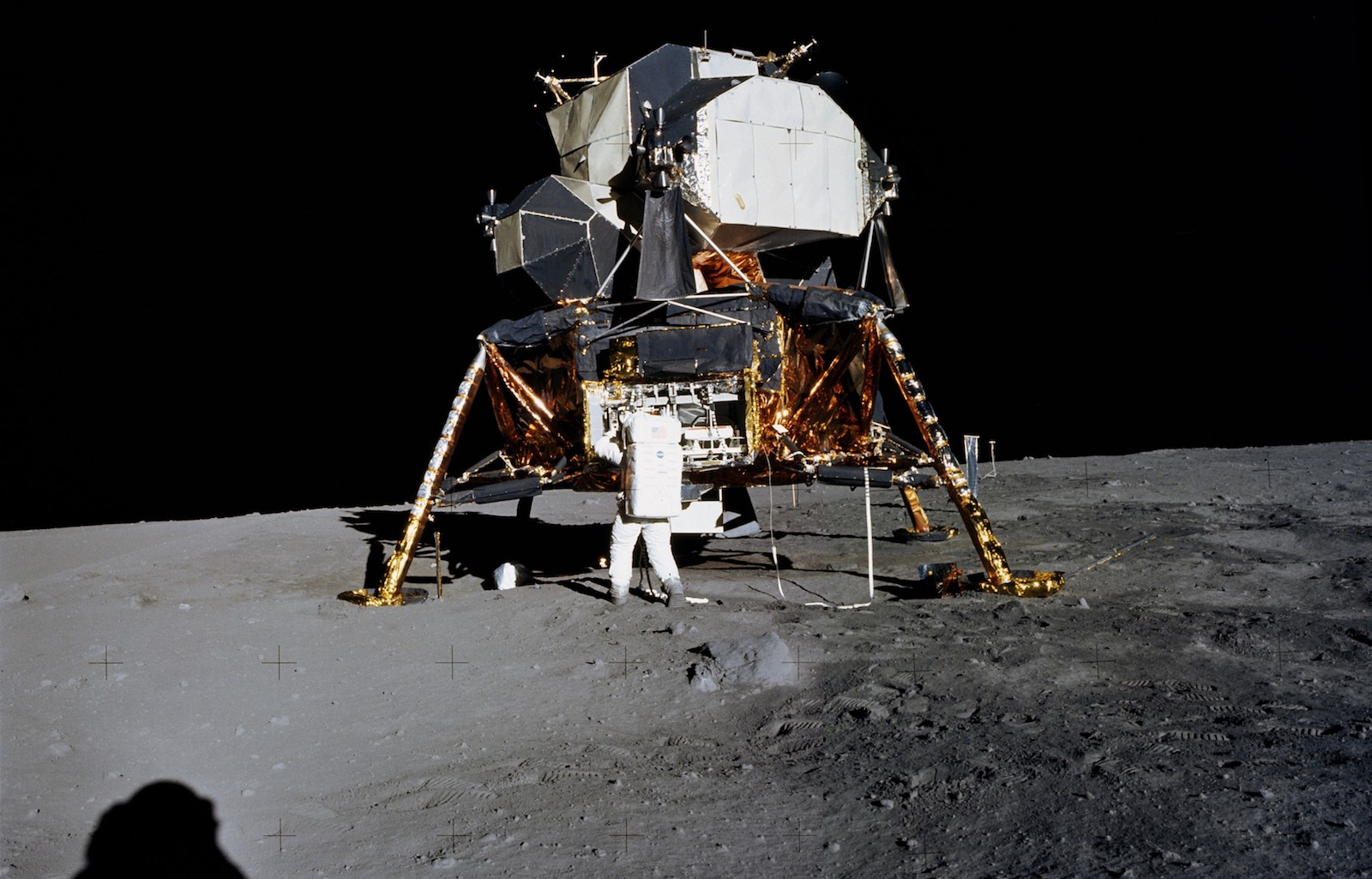 Astronaut Buzz Aldrin carrying out maintenance work on lunar module <i>Eagle</i> during the Apollo 11 lunar mission.