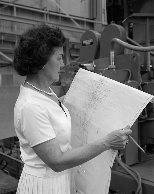 Margaret W. 'Hap' Brennecke reviews blueprints in the Manufacturing and Engineering Laboratory at Marshall Space Flight Center in October 1964. (Photo: NASA.)