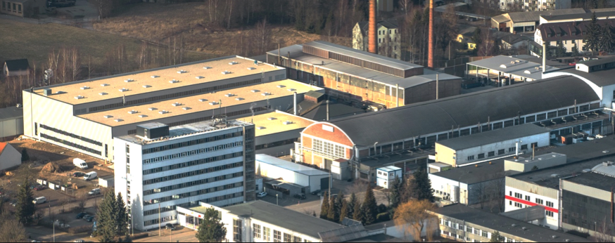Figure 1. The new melting and casting facility at BF-AT, shown here as the white building in the upper left corner.