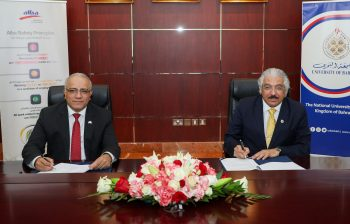 Ali Al Baqali, CEO of Alba (left), and Prof. Riyad Yousif Hamzah, president of the University of Bahrain (right), sign an MOU at the Alba premises. aluminum research