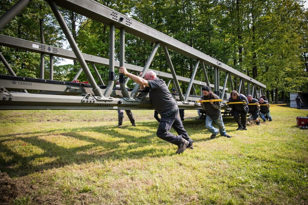 Figure 2. Only a small crew is required to set up the LVTB from one side of an obstacle. Aluminum bridge