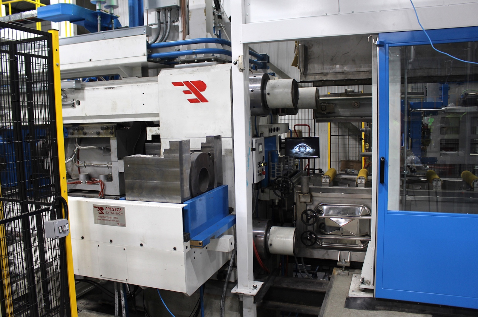 Figure 1. The new press line is not only highly automated, but also includes a number of safety features, such as cages and doors around all of the equipment.