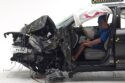 Figure 1. A Honda Pilot following the small overlap front crash test on the driver side. The position of the dummy shows that the driver compartment remained intact. (Source: IIHS.)