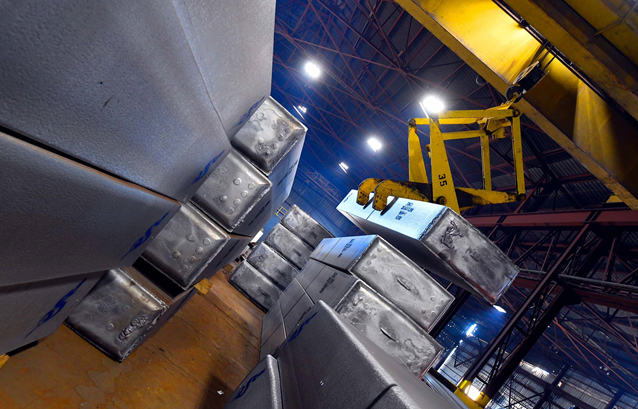 Scepter - tilted view of a storage room with aluminum rolling ingot being picked up by a crane