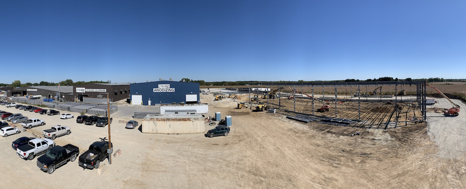 Panoramic view of Pries Enterprises, showing existing operations (left) and the new building under construction (right).